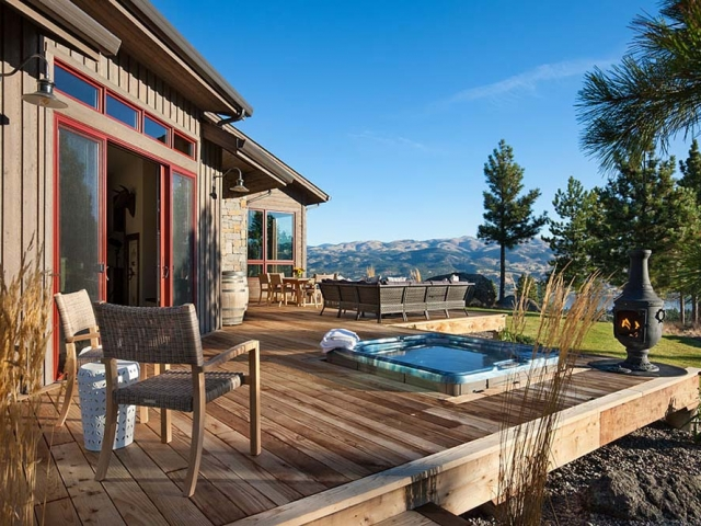 Exterior, horizontal, rear deck with hot tub looking out to mountains and Canyon Ferry Lake view, Fowler residence, Helena, Montana; Boxwoods